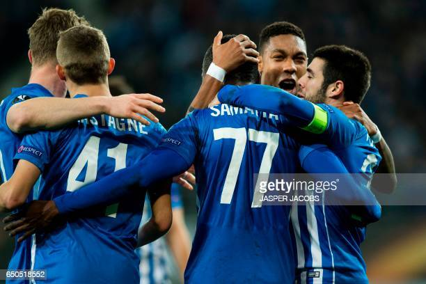 Genk's players celebrate after scoring a goal during the UEFA Europa League round of 16 football match between KAA Gent and KRC Genk in Gent on March...