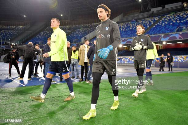 Genk's Sebastien Dewaest Genk's goalkeeper Gaetan Coucke and Genk's goalkeeper Maarten Vandevoordt pictured before the start of a training session of...