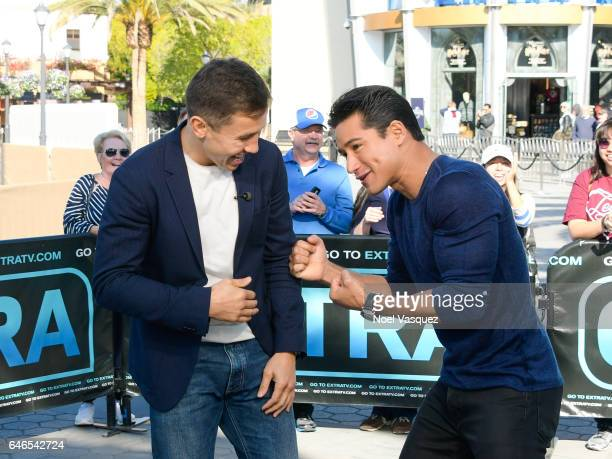 """Gennady Golovkin and Mario Lopez visit """"Extra"""" at Universal Studios Hollywood on February 28, 2017 in Universal City, California."""