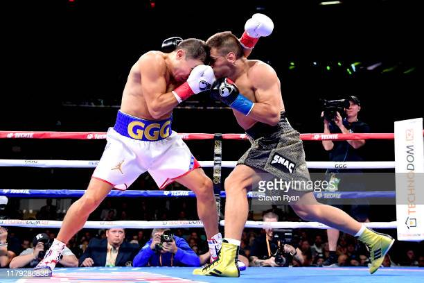 Gennady Golovkin clash heads while exchanging punches with Sergiy Derevyanchenko during their IBF middleweight title bout at Madison Square Garden on...