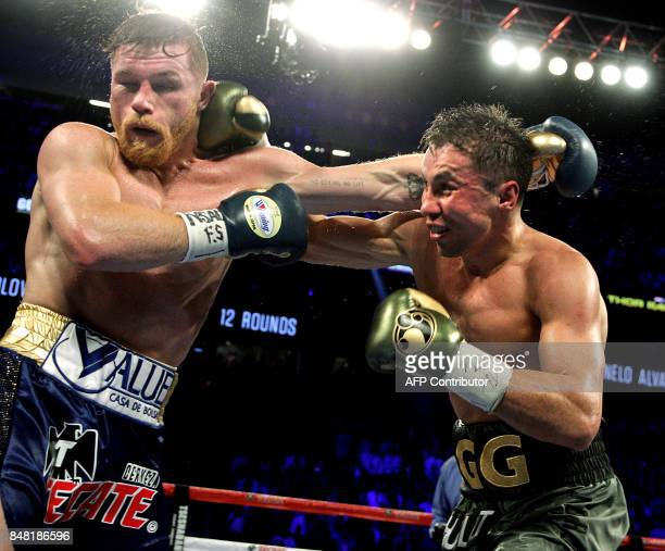 TOPSHOT Gennady Golovkin exchanges blows with Canelo Alvarez during their WBC WBA and IBF middleweight championship fight at the TMobile Arena on...