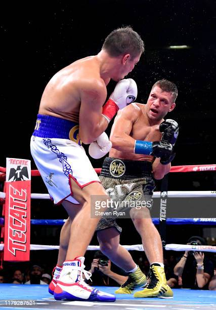 Gennady Golovkin exchanges punches with Sergiy Derevyanchenko during their IBF middleweight title bout at Madison Square Garden on October 05 2019 in...