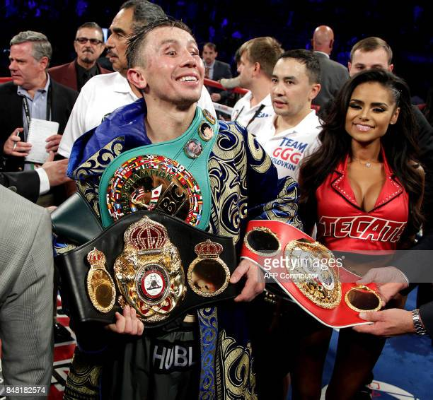 Gennady Golovkin of Kazakhstan shows his title belts following his WBC WBA and IBF middleweight championship fight with Canelo Alvarez at the TMobile...