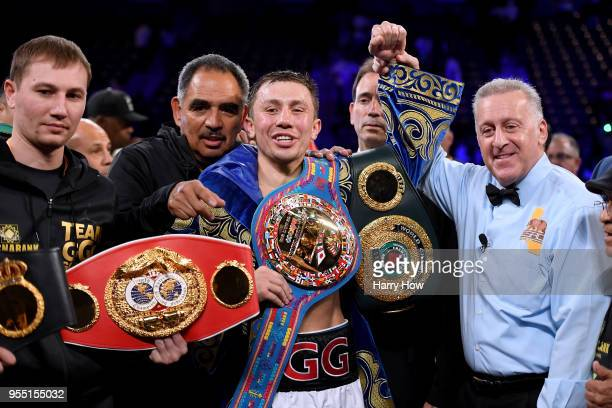 Gennady Golovkin poses with his belts with referee Jack Reiss after a second round knockout win over Vanes Martirosyan during the WBCWBA Middleweight...
