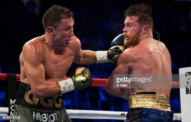 Gennady Golovkin punches Canelo Alvarez during their WBC WBA and IBF middleweight championship bout at TMobile Arena on September 16 2017 in Las...