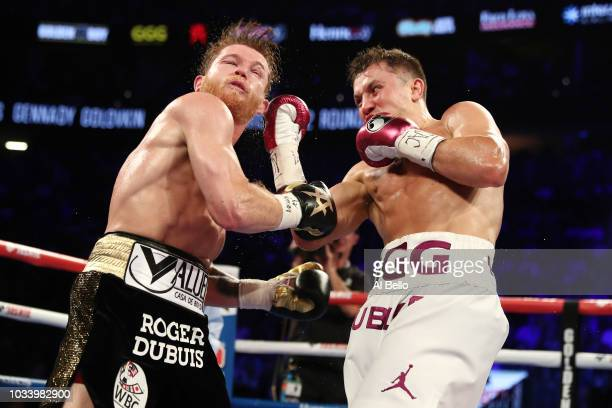 Gennady Golovkin punches Canelo Alvarez during their WBC/WBA middleweight title fight at TMobile Arena on September 15 2018 in Las Vegas Nevada