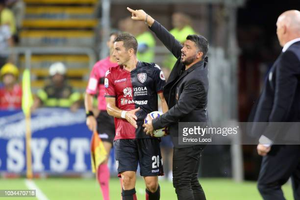 Gennaro Gattuso coach of Milan and Simone Padoin of Cagliari during the serie A match between Cagliari and AC Milan at Sardegna Arena on September 16...