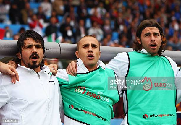 Gennaro Gattuso Fabio Cannavaro and Andrea Barzagli of Italy sing the national anthem prior to the UEFA EURO 2008 Group C match between Italy and...