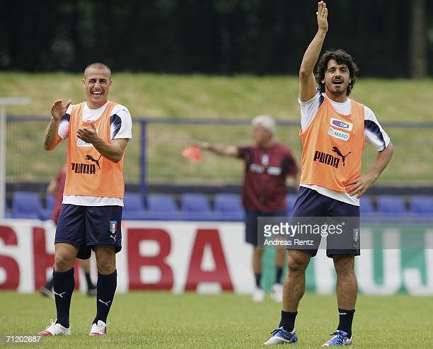 Gennaro Gattuso gestures as Fabio Cannavaro smiles during the Italy national football team training session on June 14, 2006 in Duisburg, Germany