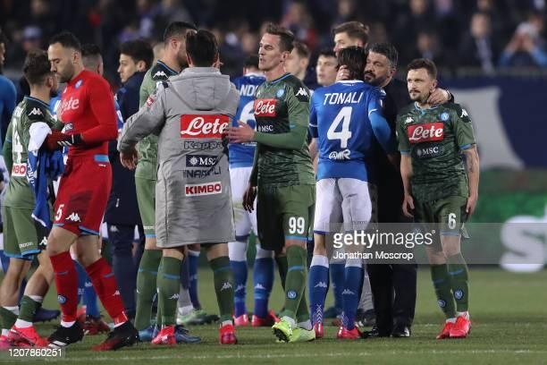 Gennaro Gattuso Head coach of Napoli embraces Mario Rui of Napoli and Sandro Tonali of Brescia after the final whistle of the Serie A match between...
