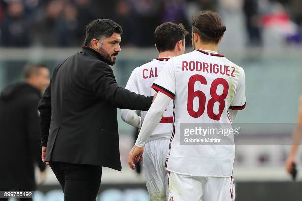 Gennaro Gattuso manager of AC Milan gestures with Ricardo Rodriguez during the serie A match between ACF Fiorentina and AC Milan at Stadio Artemio...