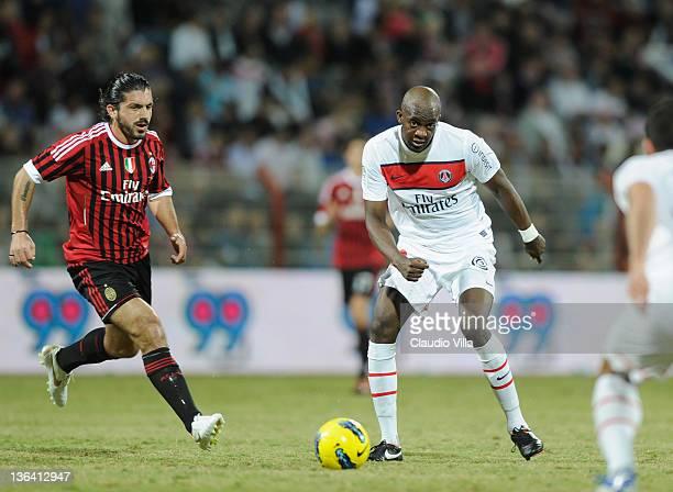Gennaro Gattuso of AC Milan and Mohamed Sissoko of Paris SaintGermain FC during the Dubai Challenge Cup match between Paris SaintGermain FC and AC...