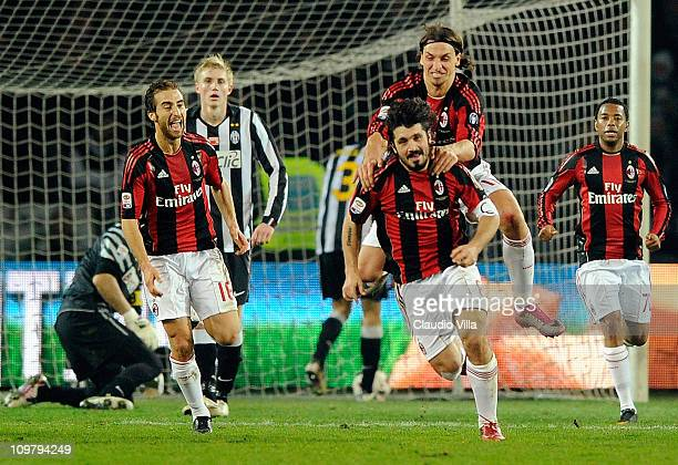 Gennaro Gattuso of AC Milan celebrates scoring the first goal during the Serie A match between Juventus FC and AC Milan at Olimpico Stadium on March...