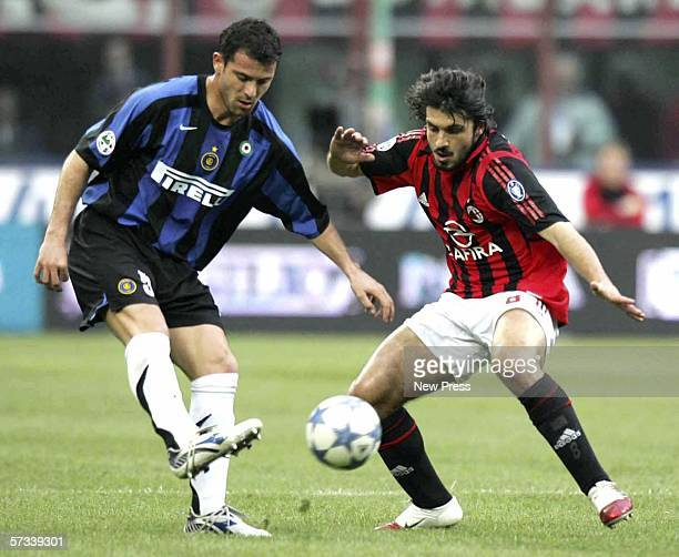 Gennaro Gattuso of AC Milan challenges Dejan Stankovic of Inter during the Serie A match between AC Milan and Inter Milan at the San Siro on April 14...