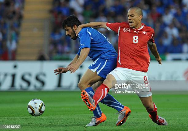 Gennaro Gattuso of Italy battles for the ball with Gokhan Inler of Switzerland during the international friendly match between Switzerland and Italy...