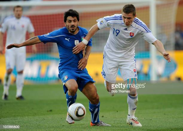Gennaro Gattuso of Italy challenged by Juraj Kucka of Slovakia during the 2010 FIFA World Cup South Africa Group F match between Slovakia and Italy...