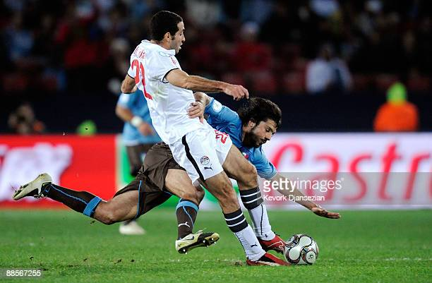 Gennaro Gattuso of Italy is tackled by Mohamed Aboutrika of Egypt during the FIFA Confederations Cup between Italy and Egypt at Ellis Park Stadium on...