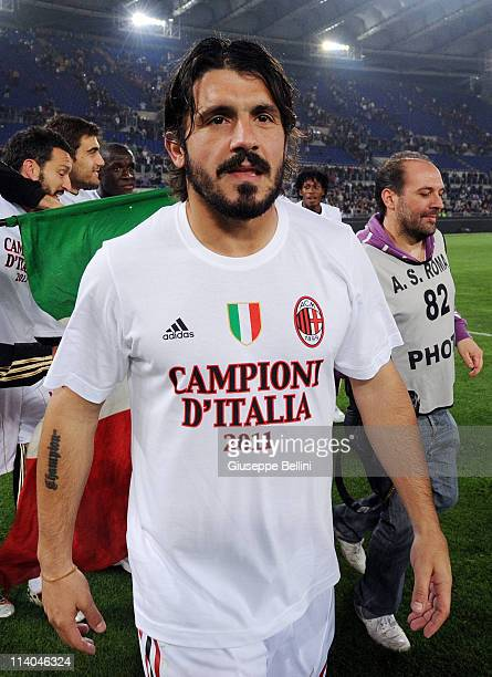 Gennaro Gattuso of Milan celebrates the victory after the Serie A match between AS Roma and AC Milan at Stadio Olimpico on May 7 2011 in Rome Italy
