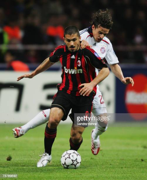 Gennaro Gattuso of Milan challenges Owen Hargreaves of Bayern during the UEFA Champions League quarter final first leg match between AC Milan and...