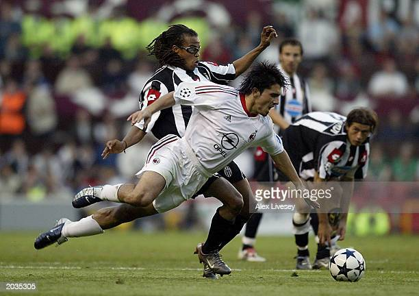 Gennaro Gattuso of Milan is tackled by Edgar Davids of Juventus during the UEFA Champions League Final match between Juventus FC and AC Milan on May...