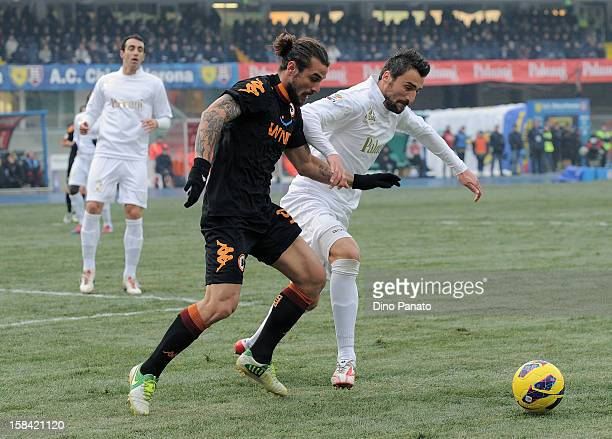 Gennaro Sardo of Chievo Verona competes with Federico Balzaretti of AS Roma during the Serie A match between AC Chievo Verona and AS Roma at Stadio...