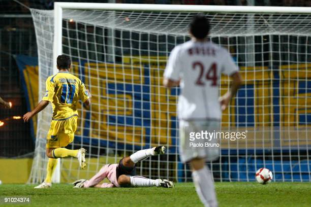 Gennaro Troianello of Frosinone Calcio scores the opening goal past Reggina Calcio's goalkeeper Mario Cassano during the Serie B match between...
