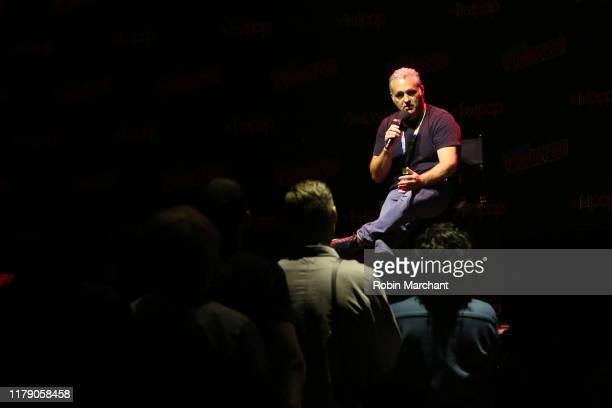 Genndy Tartakovsky speaks onstage at the Genndy Tartakovsky's Primal panel during New York Comic Con at Hammerstein Ballroom on October 04, 2019 in...