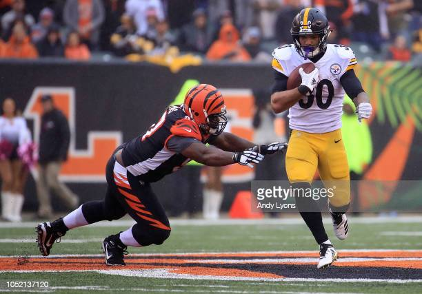 Geno Atkins of the Cincinnati Bengals attempts to tackle James Conner of the Pittsburgh Steelers during the third quarter at Paul Brown Stadium on...