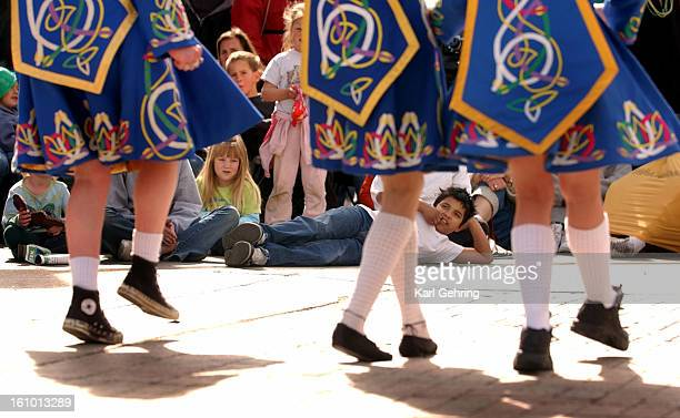 Geno Quintana <cq> ound a comfortable place to watch one of the many Irish dance squads at the 42nd annual Denver St Patrick's Day parade Saturday...