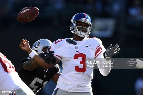 Geno Smith of the New York Giants is stripped of the ball by Bruce Irvin of the Oakland Raiders during their NFL game at OaklandAlameda County...