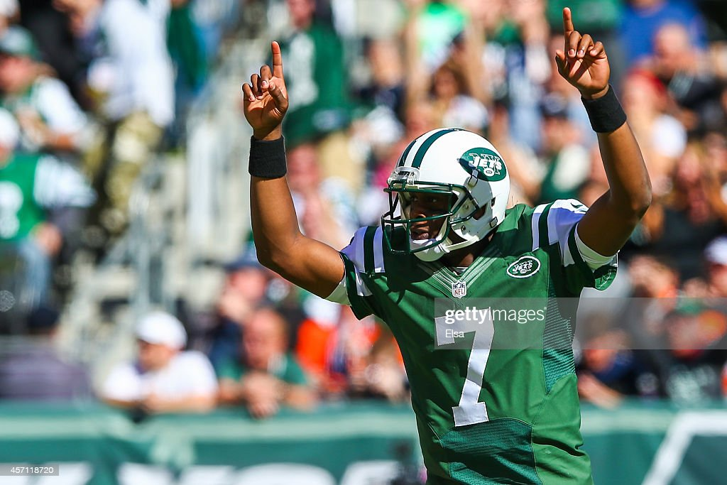 Geno Smith #7 of the New York Jets celebrates after throwing a touchdown pass to teammate Jace Amaro #88 in the first quarter during a game against the Denver Broncos at MetLife Stadium on October 12, 2014 in East Rutherford, New Jersey.