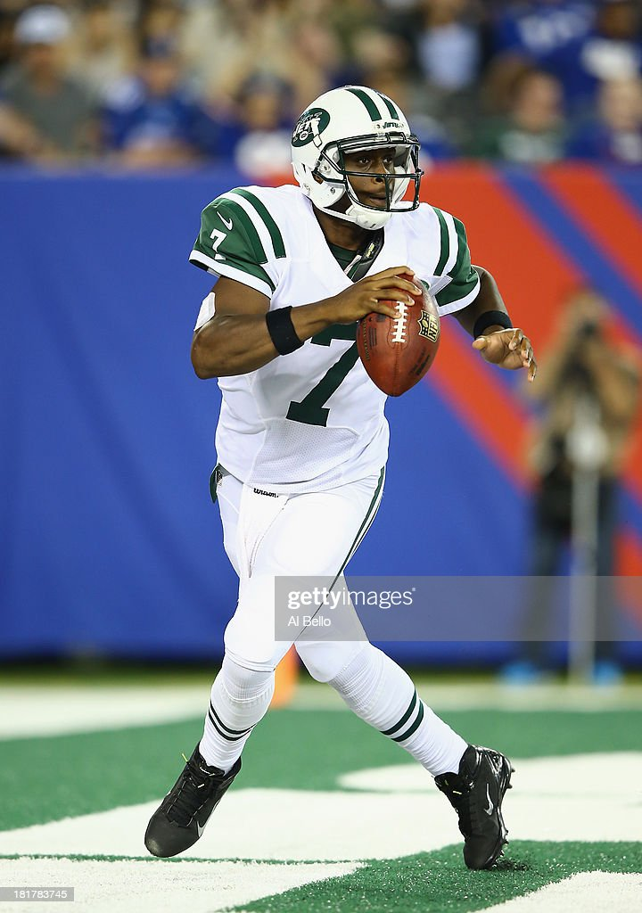 Geno Smith #7 of the New York Jets in action against the New York Giants during their pre season game at MetLife Stadium on August 24, 2013 in East Rutherford, New Jersey.