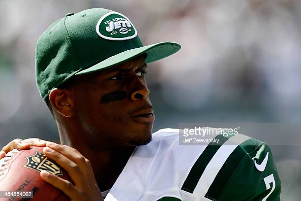 Geno Smith of the New York Jets throws during warmups for a game against the Oakland Raiders at MetLife Stadium on September 7 2014 in East...