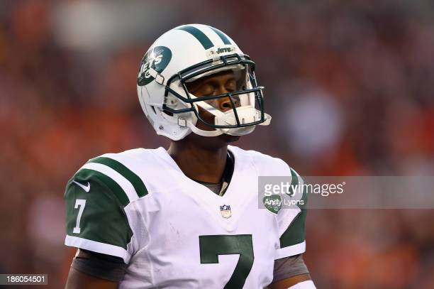 Geno Smith of the New York Jets walks off of the field in the 4th quarter after throwing an interception and having it returned for a touchdown...