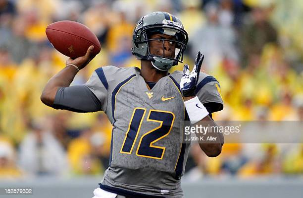 Geno Smith of the West Virginia Mountaineers drops back to pass against the Maryland Terrapins during the game on September 22 2012 at Mountaineer...