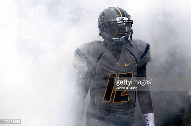 Geno Smith of the West Virginia Mountaineers leads the team onto the field before the game against the Maryland Terrapins on September 22 2012 at...