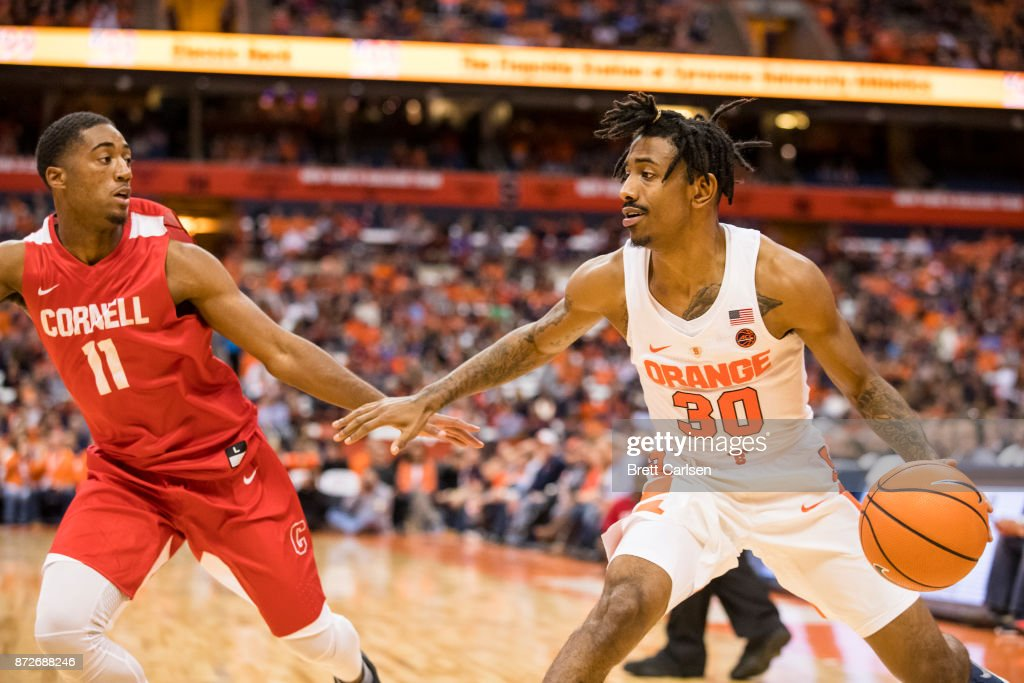 Geno Thorpe #30 of the Syracuse Orange cuts back with the ball agains Terrance McBride #11 of the Cornell Big Red during the second half at the Carrier Dome on November 10, 2017 in Syracuse, New York. Syracuse defeats Cornell 77-45.