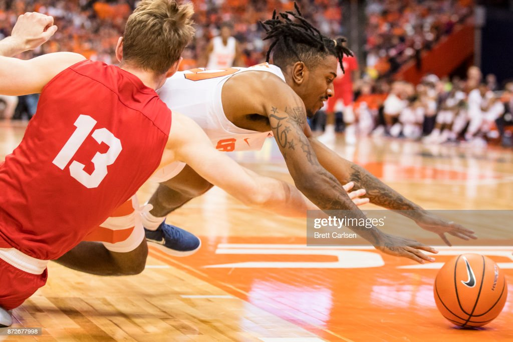 Geno Thorpe #30 of the Syracuse Orange dives on a loose ball during a full court press of Cornell Big Red during the first half at the Carrier Dome on November 10, 2017 in Syracuse, New York.