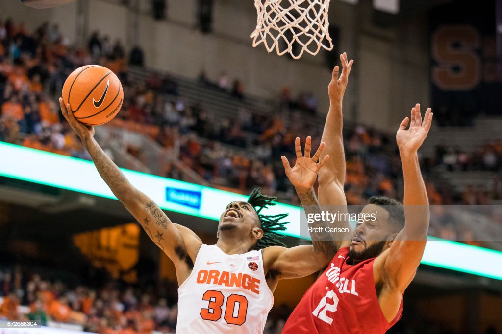 Geno Thorpe #30 of the Syracuse Orange puts in a lay up as he pushes away Jordan Abdur-Ra'oof #12 of the Cornell Big Red during the second half at the Carrier Dome on November 10, 2017 in Syracuse, New York. Syracuse defeats Cornell 77-45.