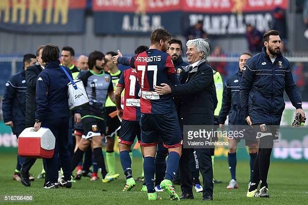Genoa CFC head coach Gian Piero Gasperini celebrates victory with Panagiotis Tachtsidis at the end of the Serie A match between Genoa CFC and Torino...
