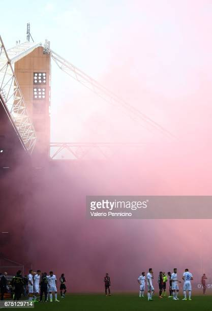 Genoa CFC supporters throw smoke bombs and flares during the Serie A match between Genoa CFC and AC ChievoVerona at Stadio Luigi Ferraris on April 30...