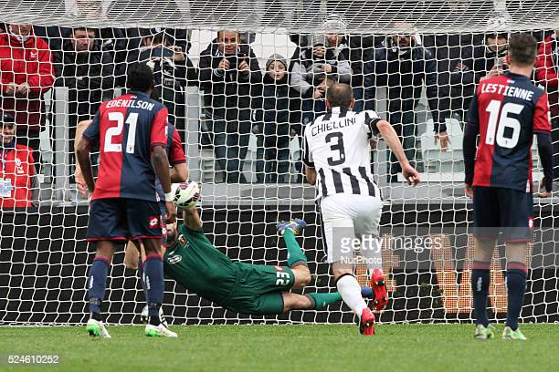 Genoa goalkeeper Eugenio Lamanna dives for the ball saving penalty shooted by Juventus forward Carlos Tevez during the Serie A football match n28...
