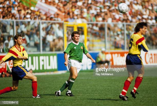 Genoa , Italy - 25 June 1990; Ray Houghton of Republic of Ireland in action against Ioan Andone and Iosif Rotariu of Romania during the FIFA World...
