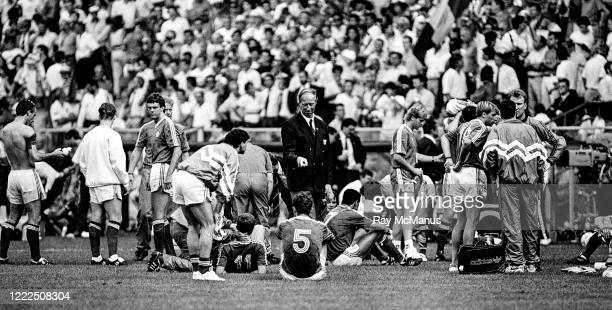 Genoa Italy 25 June 1990 Republic of Ireland manager Jack Charlton speaks to his players prior to the penalty shoot out during the FIFA World Cup...