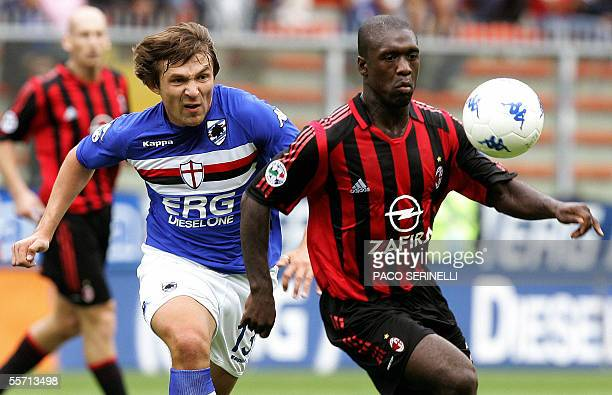 Milan's midfielder Clarence Seedorf fights for the ball with Sampdoria's midfielder Vitali Kutuzof, during their serie A football match Sampdoria-AC...