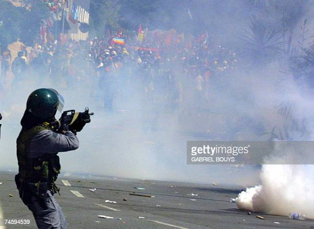 - Picture taken 21 July 2001 of a Guarda di Finanza aiming at anti-globalisation activists during a protest against the G8 summit in Genoa .In 2001,...