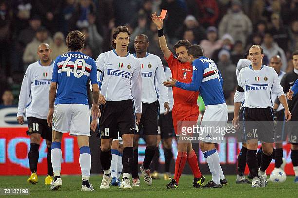 Sampdoria's midfielder Gennaro Delvecchio receives a red card by referee Marco Rizzoli after headbutting Inter Milan's Marco Materazzi during their...