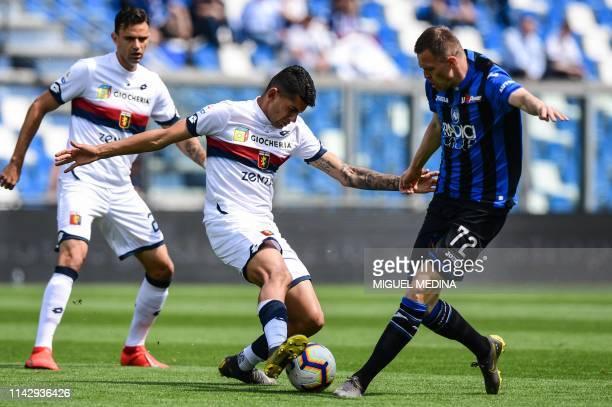 Genoa's Argentine defender Cristiano Romero challenges Atalanta's Slovenian midfielder Josip Ilicic during the Italian Serie A football match...