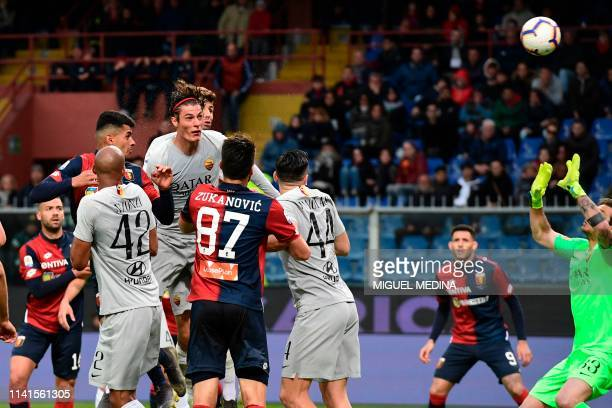 Genoa's Argentine defender Cristiano Romero heads the ball to score during the Italian Serie A football match between Genoa and AS Roma on May 5 at...
