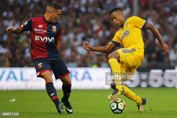 Genoa's Argentinian forward Ricardo Centurion fights for the ball with Juventus' Brazilian defender Alex Sandro during the Italian Serie A football...